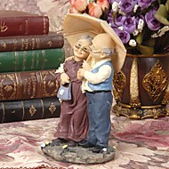 kakku murskaimet kaunis parit pitävät sateenvarjon sateessa kakku silinteri