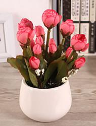 rosa rosa flores artificiales brote con el florero
