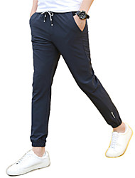 Men's Solid Casual / Sport SweatpantsPolyester / Spandex Black / Blue