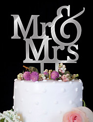An acrylic mirror silver wedding cake decorated with a cake decorated with a birthday cake