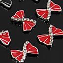 指先ネイルアートの装飾のための10個入り赤いリボンラインストーン合金アクセサリー